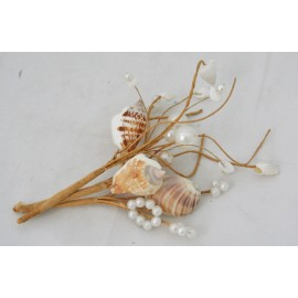 Pick with shells and pearls