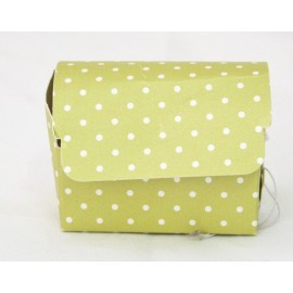 The box to the top box with the. Green with white polka dots